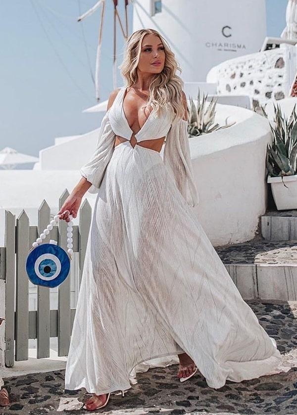 vestido longo branco com maga longa e recortes na cintura