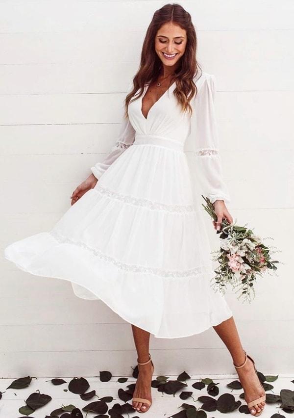 vestido branco midi fluido com manga longa